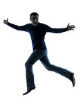 Man happy jumping saluting silhouette full length Royalty Free Stock Photos