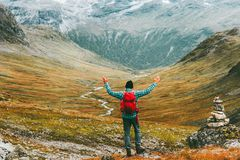 Man happy raised hands with backpack exploring mountains royalty free stock images