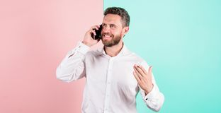 Man happy received new job. Man talk using smartphone. Mobile communication keep friendly relations. Man bearded smiling. Face call mobile phone. Interesting royalty free stock photos