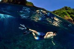 Man happy skin diving. stock image