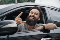 Close up side portrait of happy man driving car Stock Photo