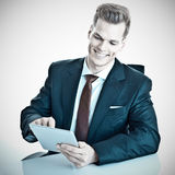Man happy using tablet or i Pad Stock Photography