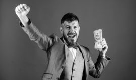 Man happy winner rich hold pile of dollar banknotes blue background. Easy cash loans. Win lottery concept. Businessman. Got cash money. Get cash easy and stock photos