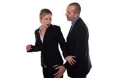 Man harassing woman. Man touching women in a strange way Royalty Free Stock Photos