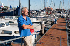 Man in harbor Stock Image