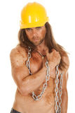 Man hard hat chain mud arm across chest Stock Photos