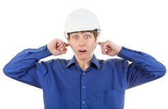 Man in Hard Hat with Closed Ears Stock Image