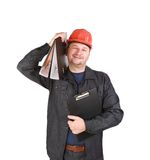 Man in hard hat holding folders. Royalty Free Stock Photos