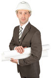 Man with hard hat holding rolled up blueprints. On white background Stock Photo