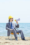 Man with hard hat and loudspeaker Royalty Free Stock Photography