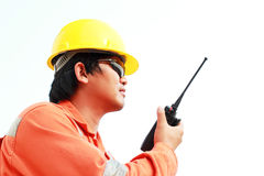 Man in hard hat using walkie talkie Stock Photography