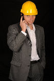 Man in hardhat on cellphone Stock Photo