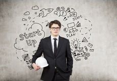 Man in hardhat, concrete wall, start up icons Stock Photography