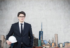 Man in hardhat and glasses, colored city Royalty Free Stock Photography