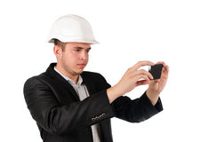 Man in a hardhat taking a photograph Stock Photos