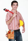 Man with hardhat and wrench Royalty Free Stock Photography
