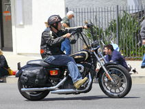 Man on a Harley. A man riding a Harley Davidson Motorcycle durin the annual Burbank on Parade, Burbank CA 4/14/2012 royalty free stock image