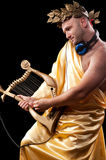 Man with a harp Royalty Free Stock Images