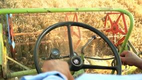 Man harvesting crop driving combine. stock footage