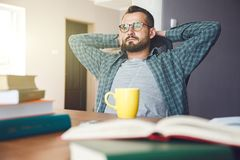 Man has break after reading work royalty free stock photography