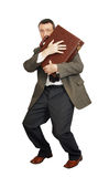 Man has clasped a suitcase by his hands Stock Images