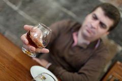 Man has degustation of brandy Royalty Free Stock Photo