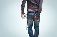 Man has diarrhea. Man holding toilet paper and butt. Royalty Free Stock Photos