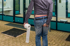 Man has diarrhea. Man holding toilet paper and his butt. Royalty Free Stock Images