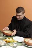 Man has early breakfast Stock Image