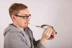 A man has a fish in his hand Royalty Free Stock Photo
