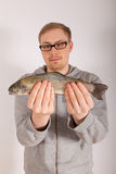 A man has a fish in his hand Royalty Free Stock Photos