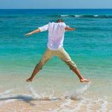 Man has fun in the blue sea Stock Photos