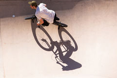 Man has fun with his BMX at the skatepark Royalty Free Stock Image