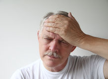 Man has a headache Stock Photo