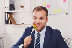 Man has healthy business lunch in modern office interior Royalty Free Stock Photo