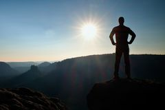 A man has his hands on  hips. Sportsman  silhouette in nature at daybreak. Royalty Free Stock Photography