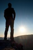 A man has his hands on  hips. Sportsman  silhouette in nature at daybreak. Stock Image