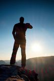 A man has his hands on  hips. Sportsman  silhouette in nature at daybreak. Stock Photography
