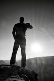 A man has his hands on  hips. Sportsman  silhouette in nature at daybreak. Stock Images