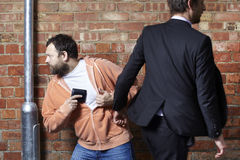Man has his wallet pickpocketed Stock Photo
