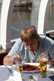 Man has lunch Stock Photo