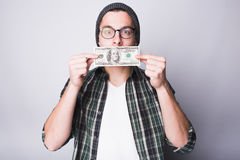 Man has money and he is satisfied. Guy is kissing 100 dollars banknote and making wish to have more stock photos