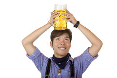 Man has Oktoberfest beer stein on his head Royalty Free Stock Image