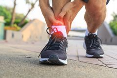 The man has pain at the ankle. / ankle pain Royalty Free Stock Photo