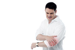 Man has pain in the elbow Stock Photo