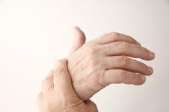 Man has painful hand Royalty Free Stock Photos