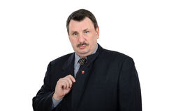 Man has pinned communist badge. Fat mature man has pinned communist badge on back side of lapel Royalty Free Stock Images