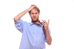 Man has a problem with binding tie Royalty Free Stock Image