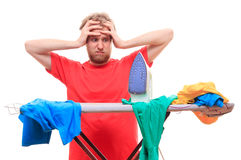 Man has a problem with ironing on board Royalty Free Stock Photography
