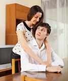 Man has problem, young woman comforting him Royalty Free Stock Image
